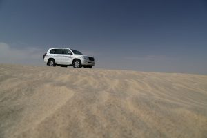 Our 4wd vehicle parked on top of a sand dune