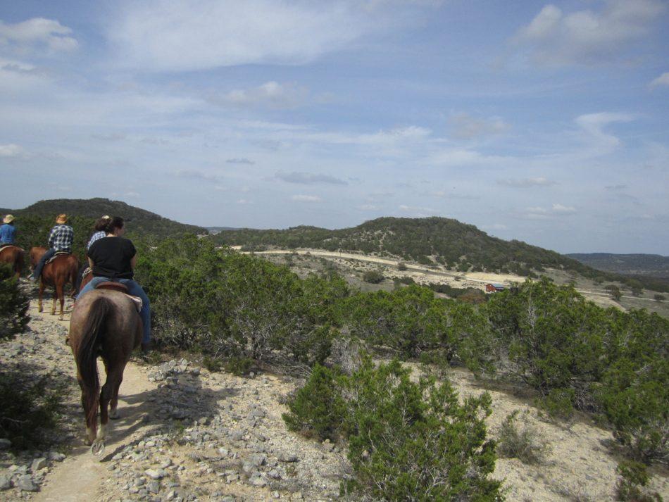 Horse riding around Silver Spur Ranch Bandera, TX