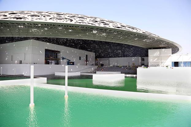 Temporary walls removed to allow the sea to surround the building, realising the architect's vision for the world-class cultural institution to float on the Arabian Gulf. Courtesy TDIC, Architect: Ateliers Jean Nouvel