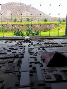 Model of the excavated portion of the cityshowing Pyramid of the Sun in front, Pyramid of the Moon at the end of Avenue of the Dead. Actual Pyramid of the Sun visible in background.