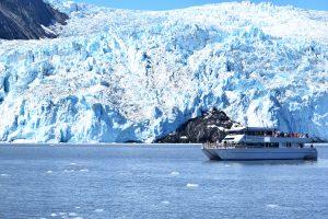 A tour boat passes Aialik glacier.