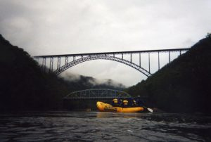 Two bridges are visible from the New River, the New River Gorge Bridge and the Fayette Station Bridge.
