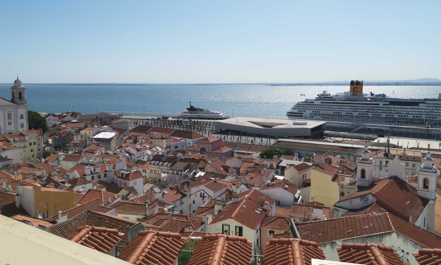 Lisbon travel tips - Shows the Alfama district from above